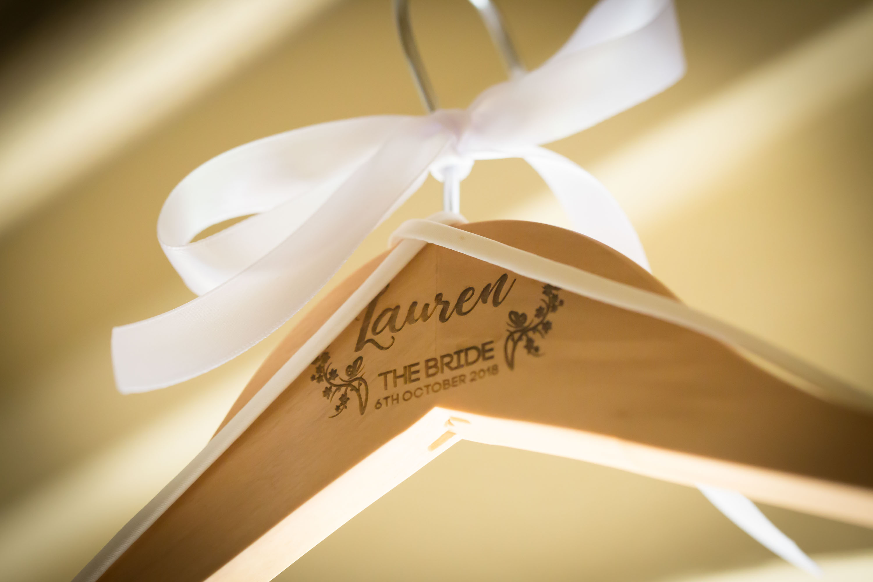 designer hanger with brides name on and wedding date