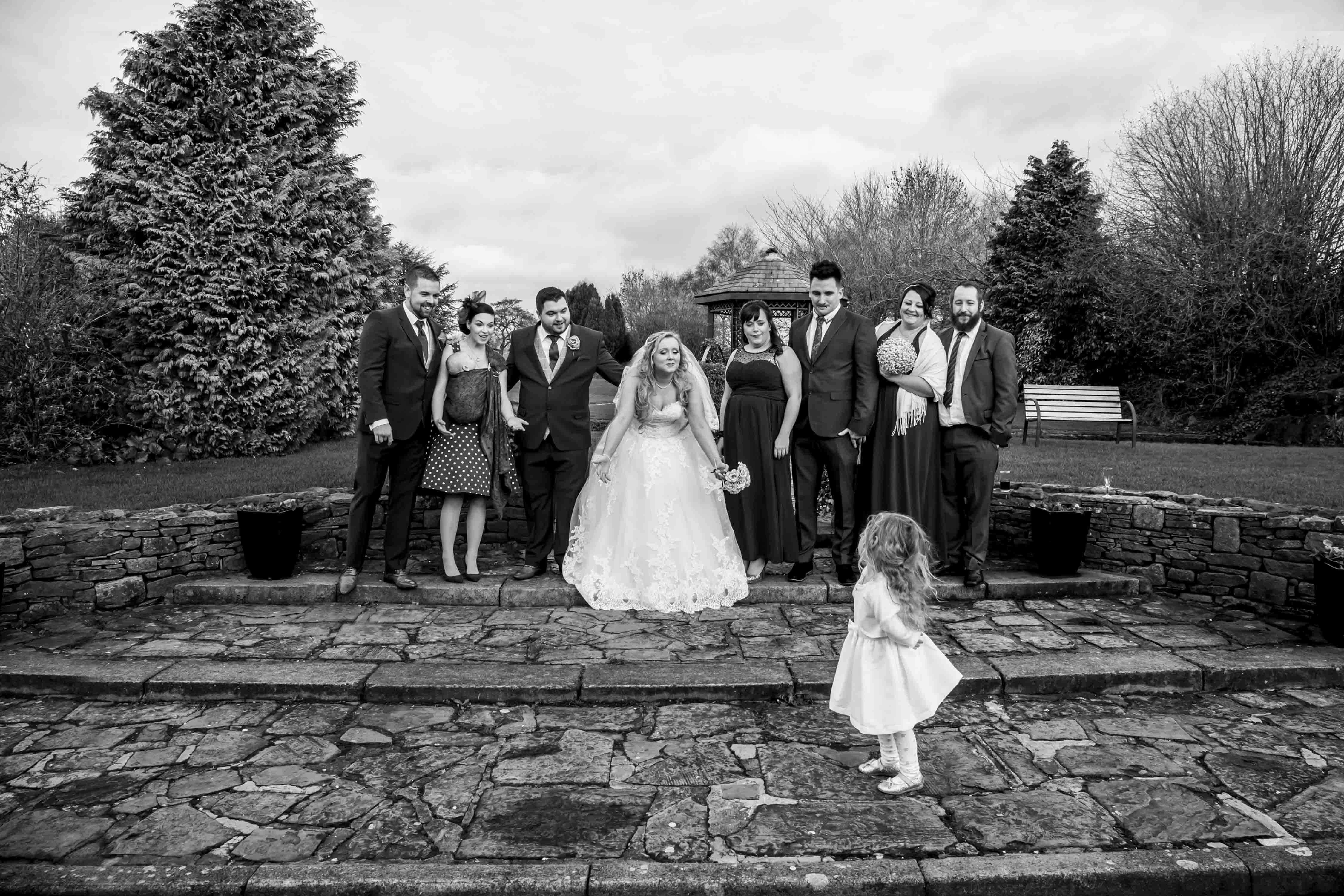 flower girl refuses to be part of a group portrait