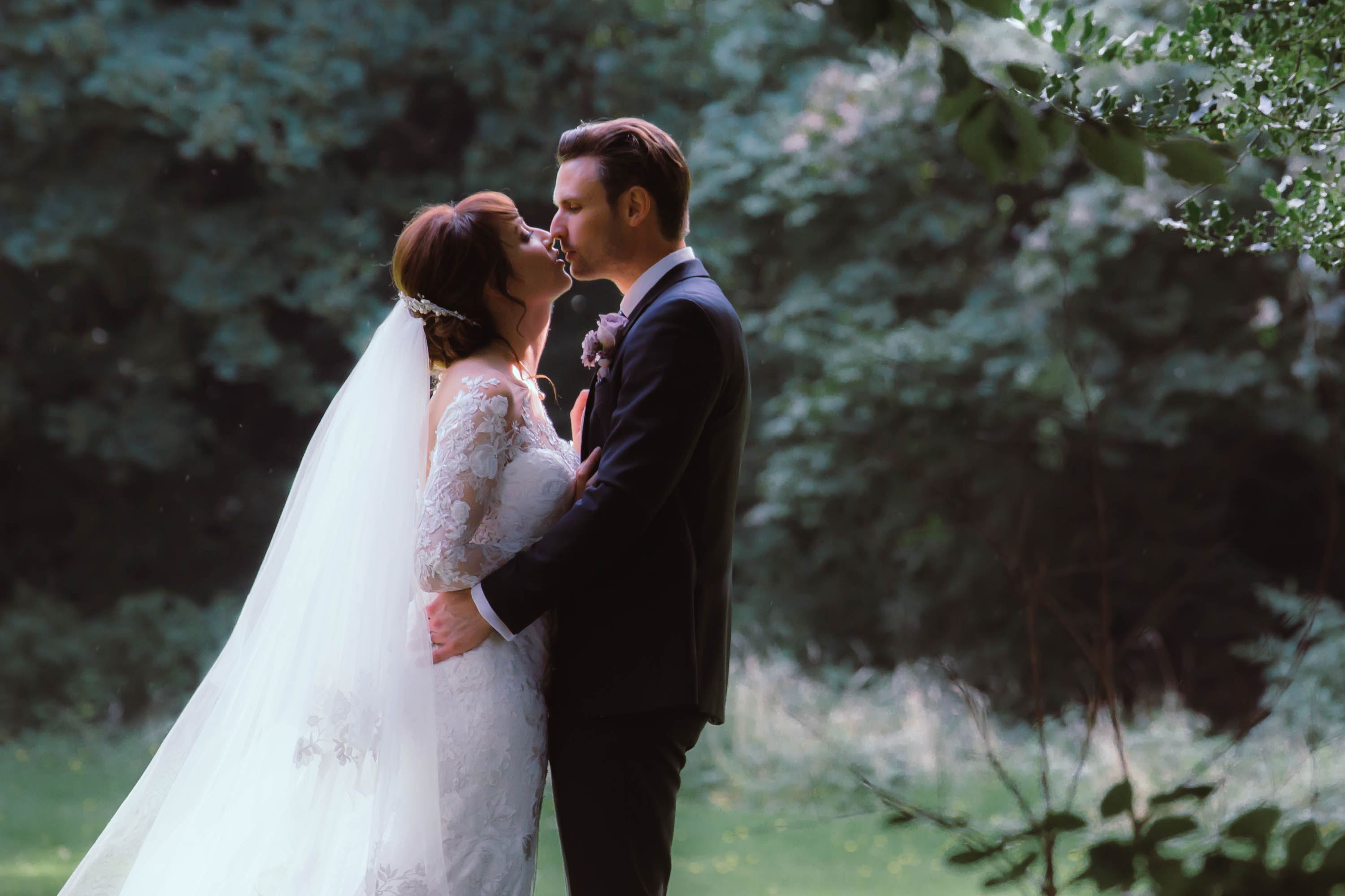 bride and groom have romantic kiss in ashfield house gardens