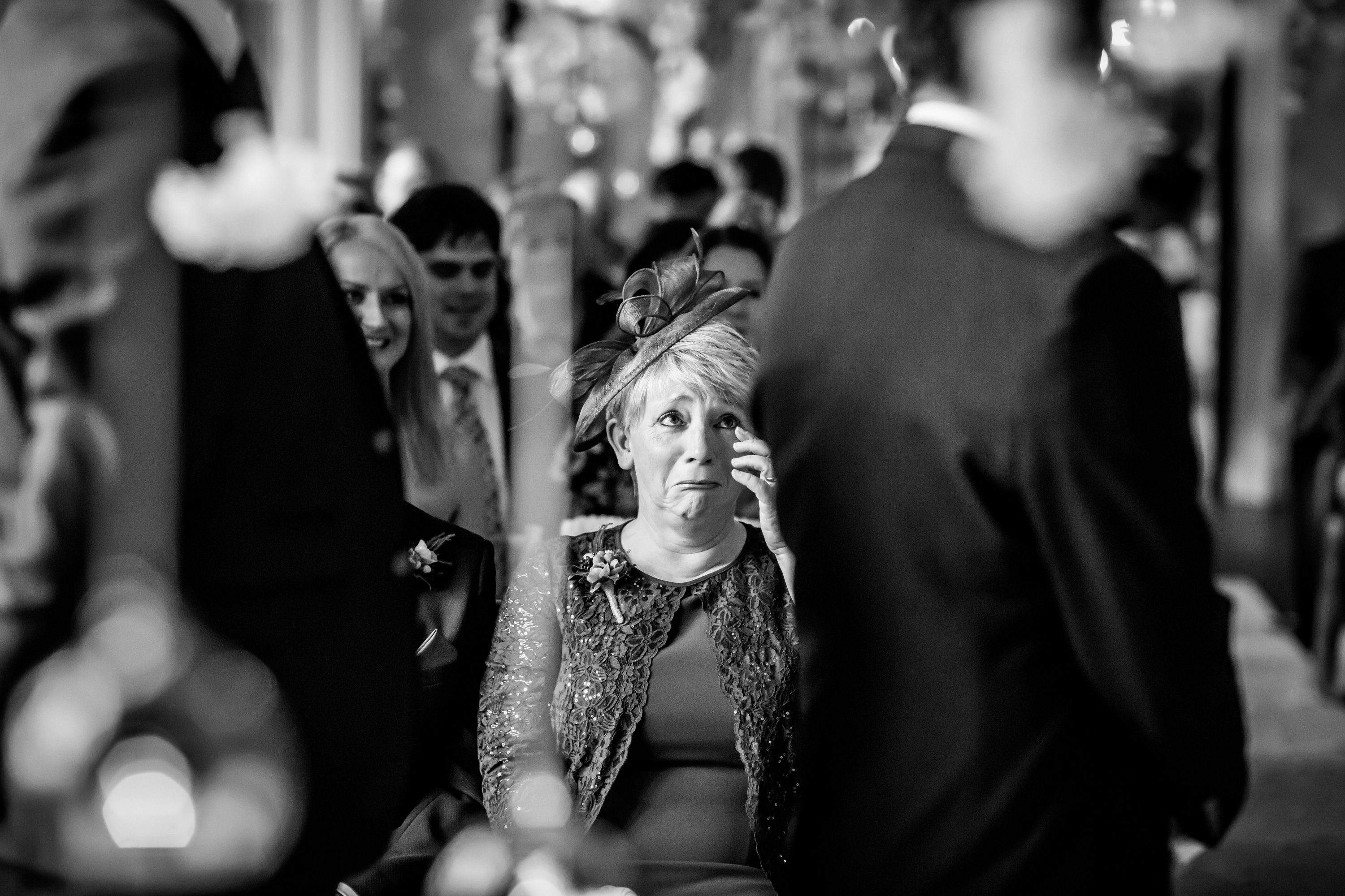 Mother of the groom cries at the wedding ceremony at Falcon Manor
