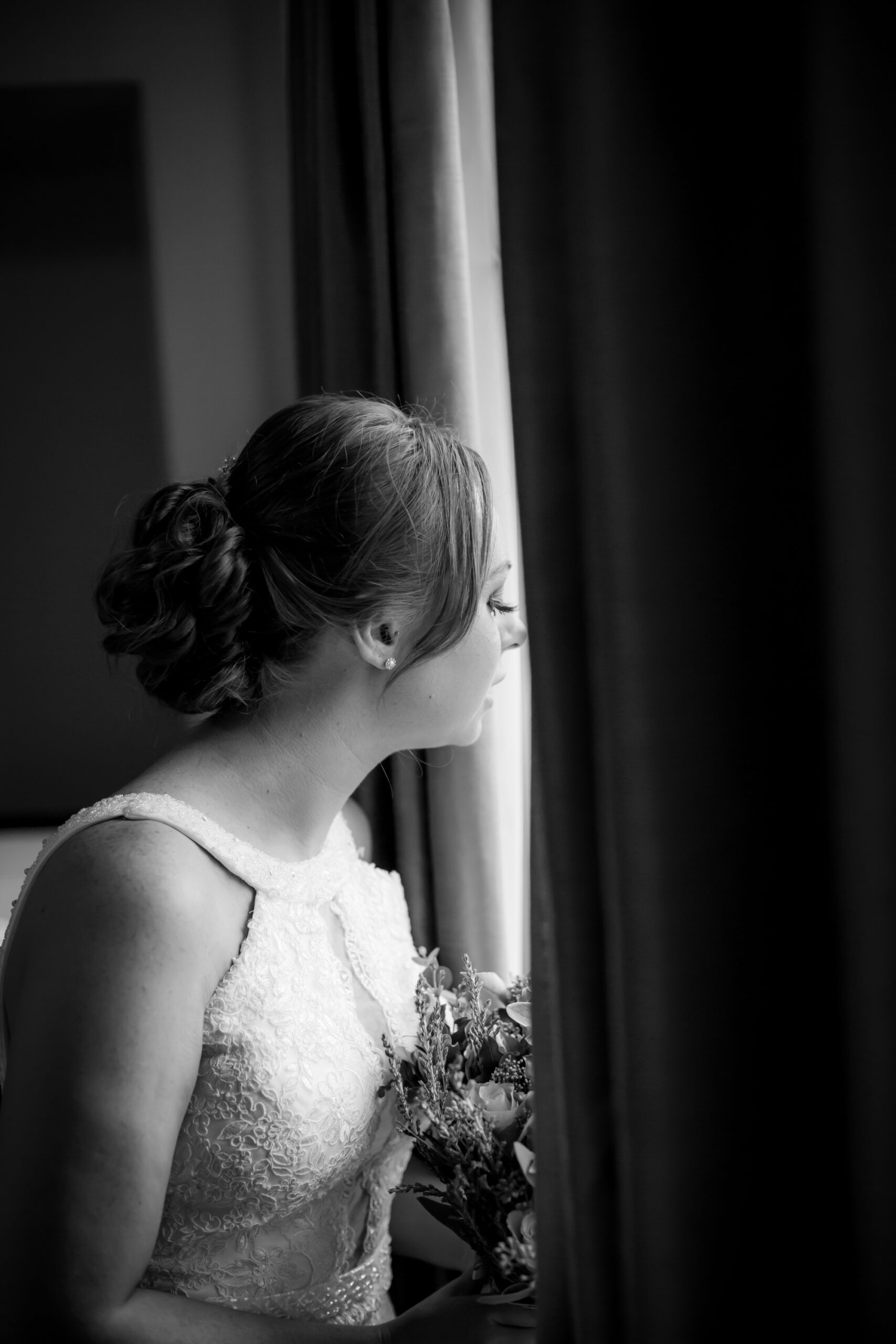 Bride looks out of the window at gretna green hotel