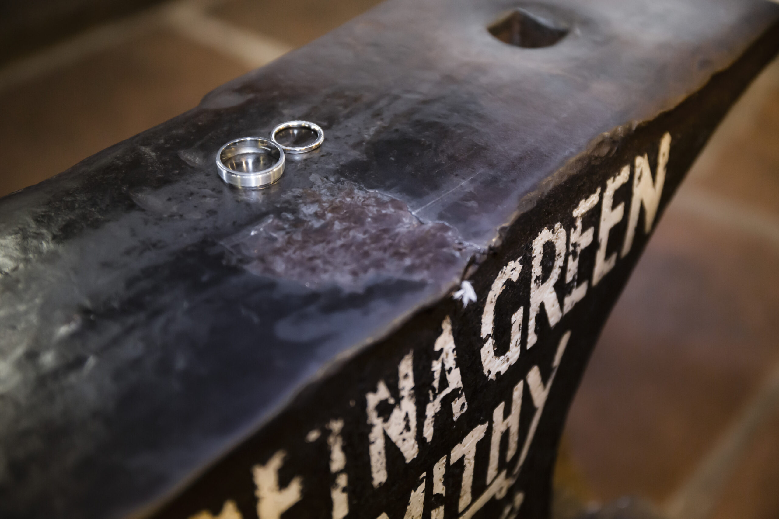 wedding rings on top of the famous gretna green smithy anvil