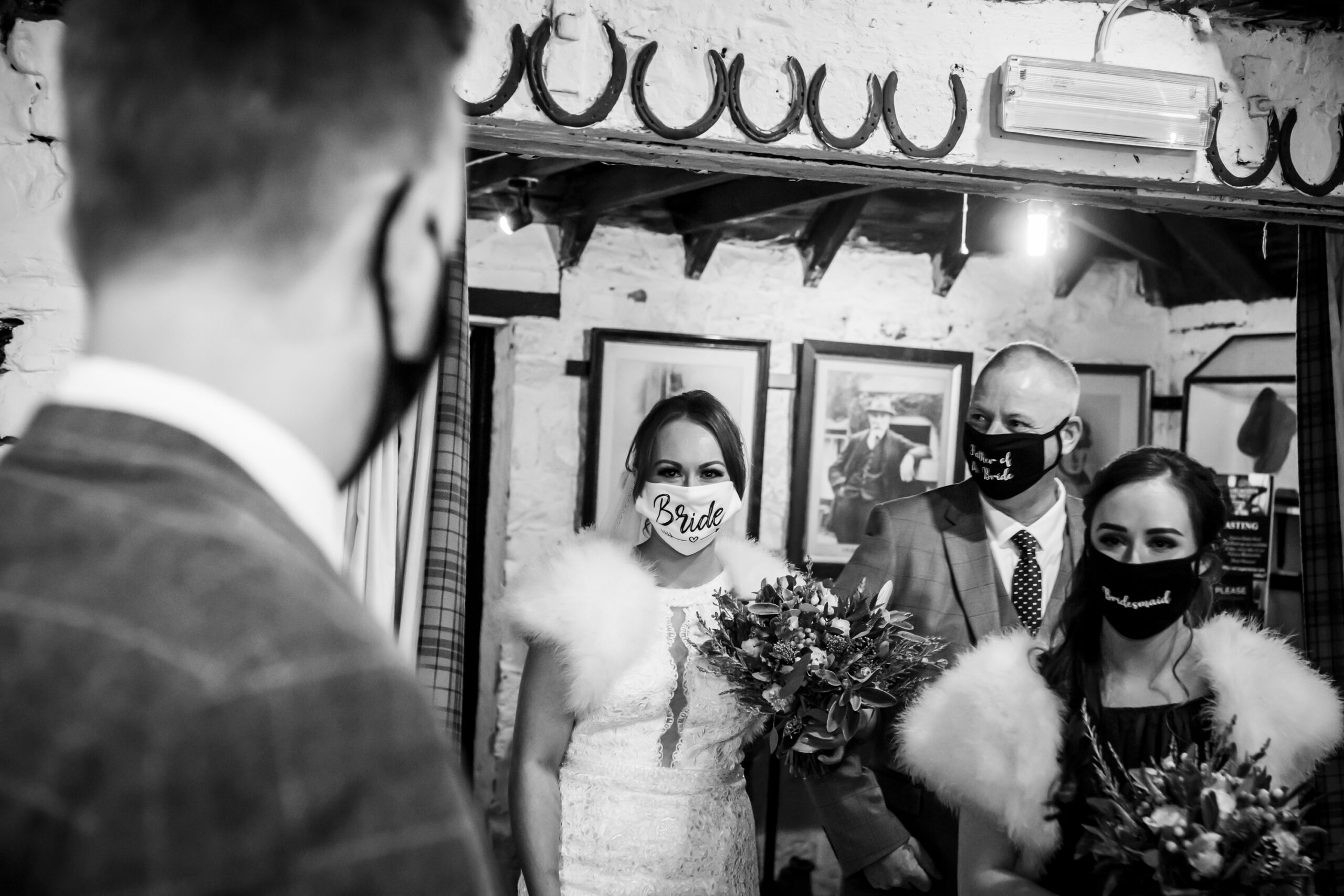 the bride enters the ceremony room at the old blacksmiths shop in gretna green