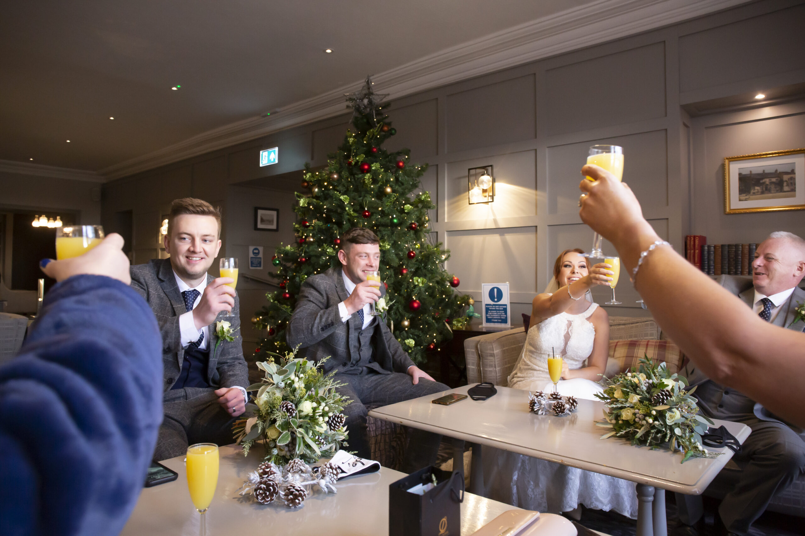 wedding party toast the bride and grooms marriage at gretna green hotel
