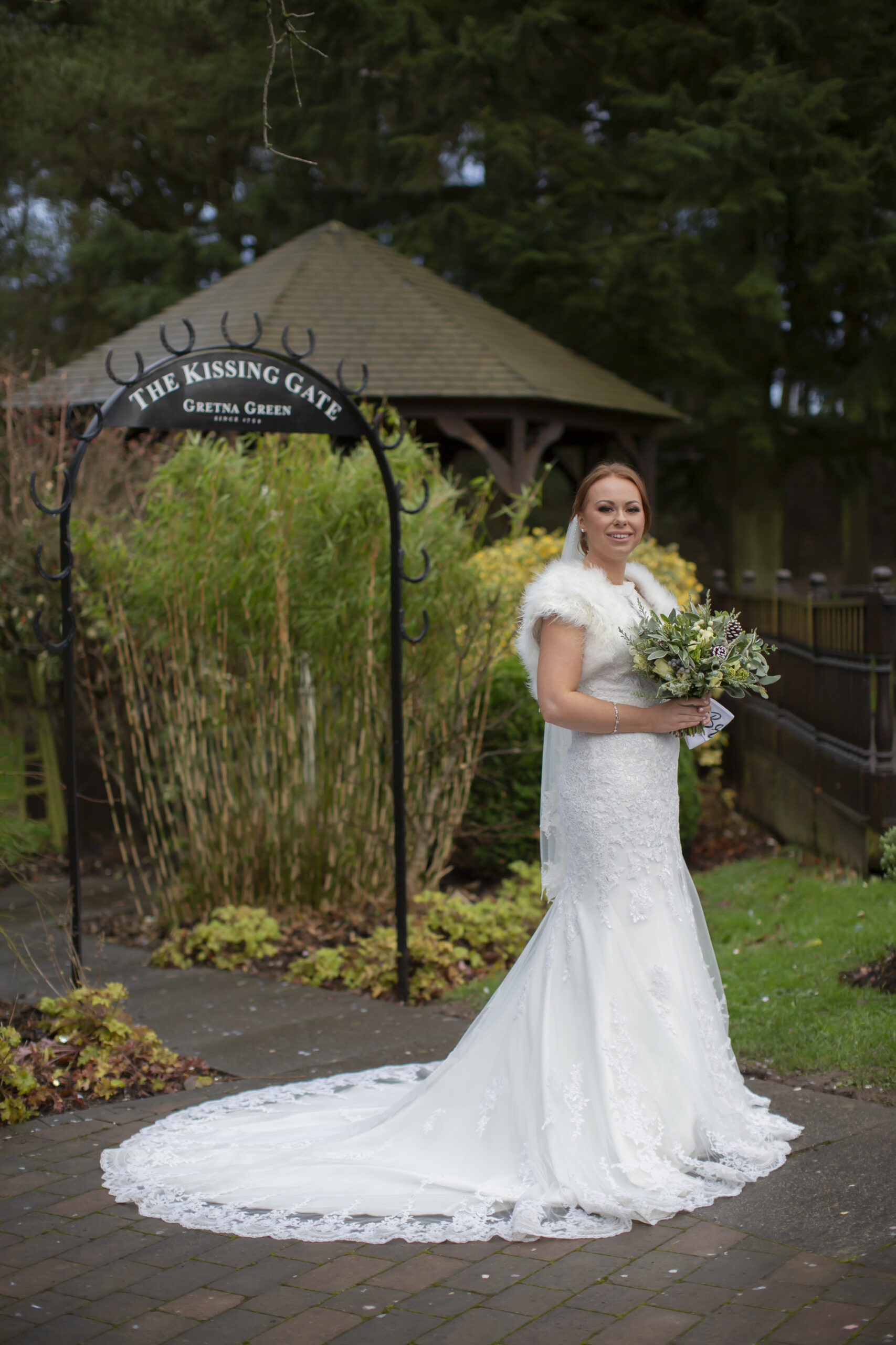 gorgeous bride portrait at the kissing gate at gretna green hotel