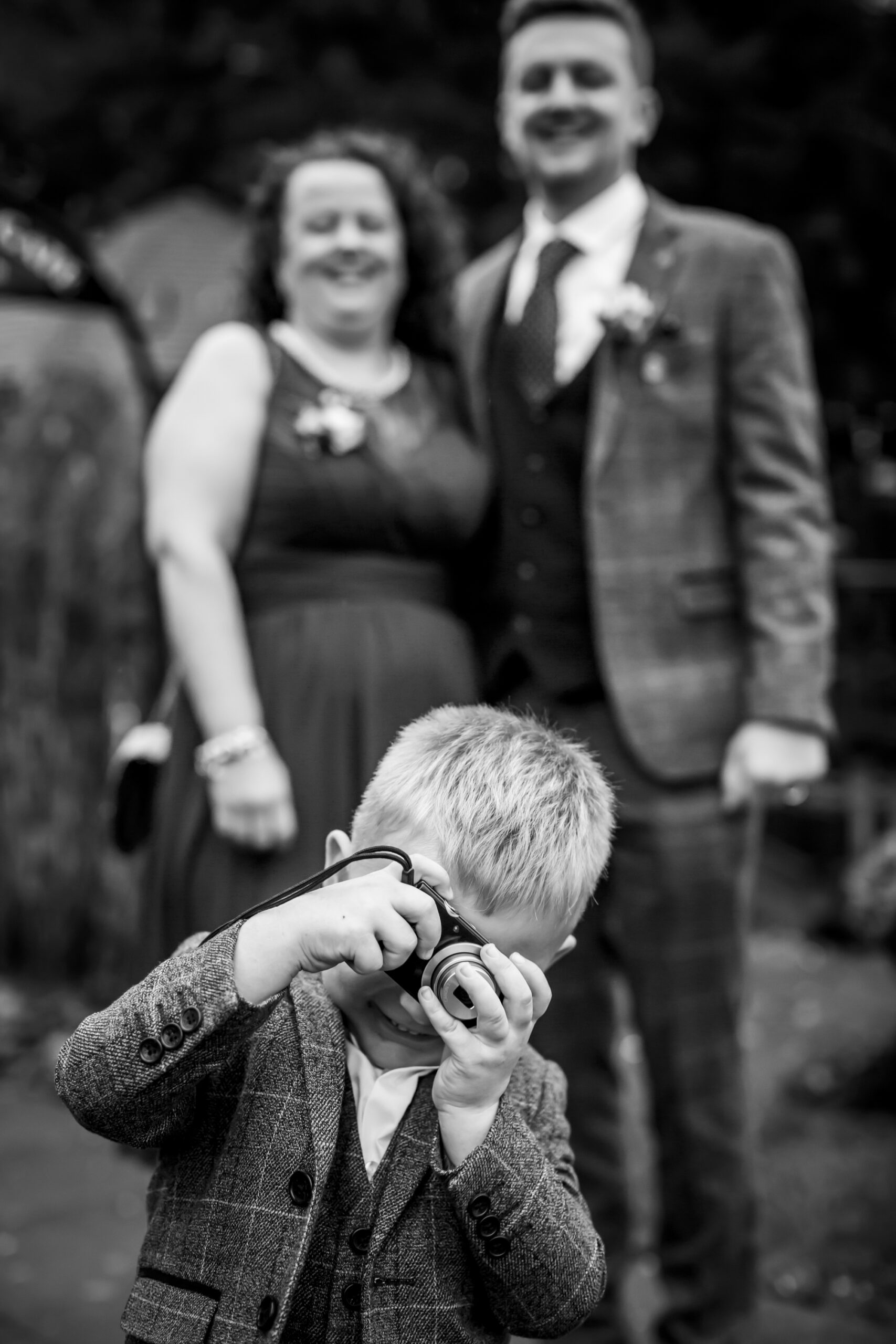 page boy takes a photo of the photographer at gretna green hotel