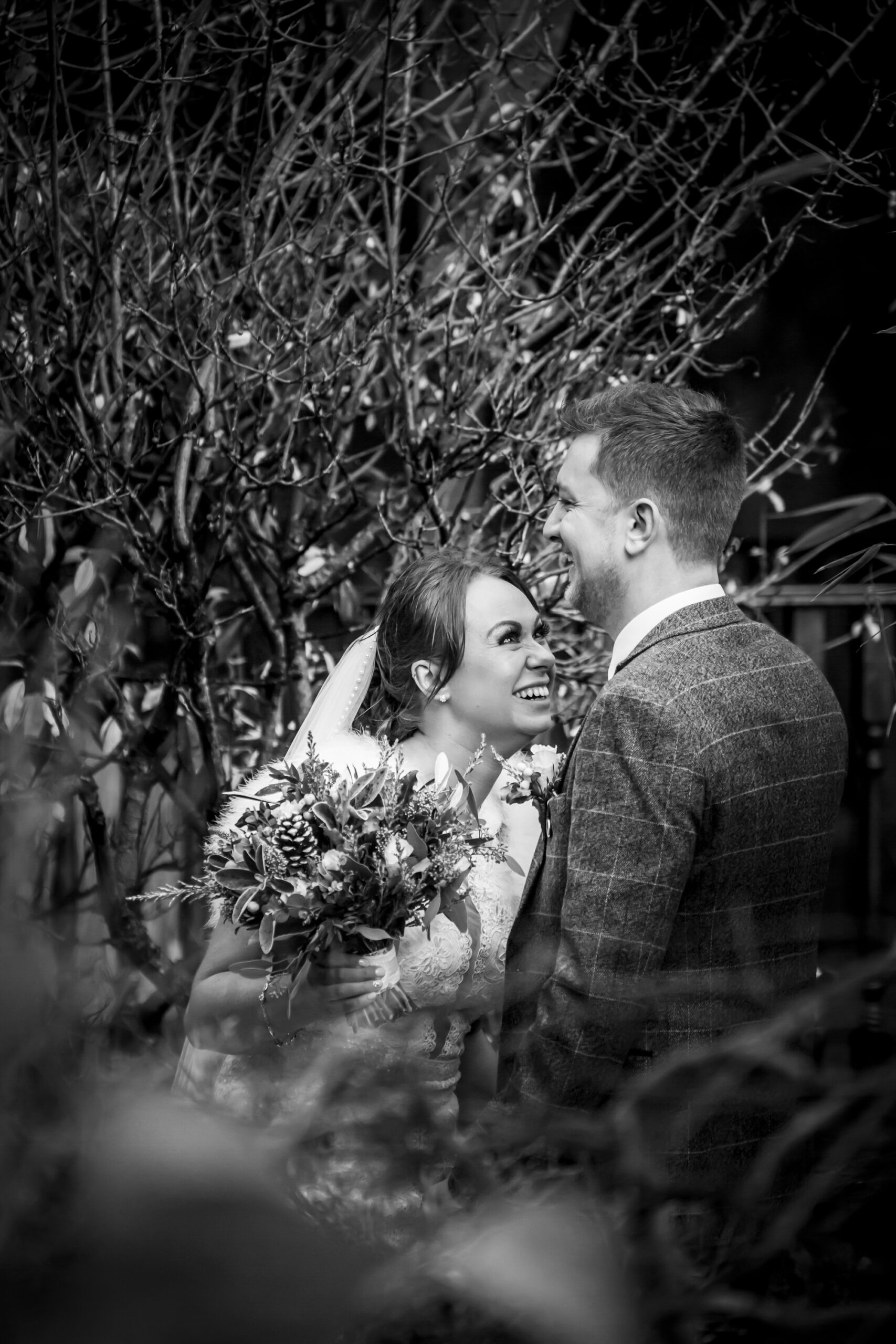 gorgeous bride and groom portrait at the kissing gate at gretna green hotel
