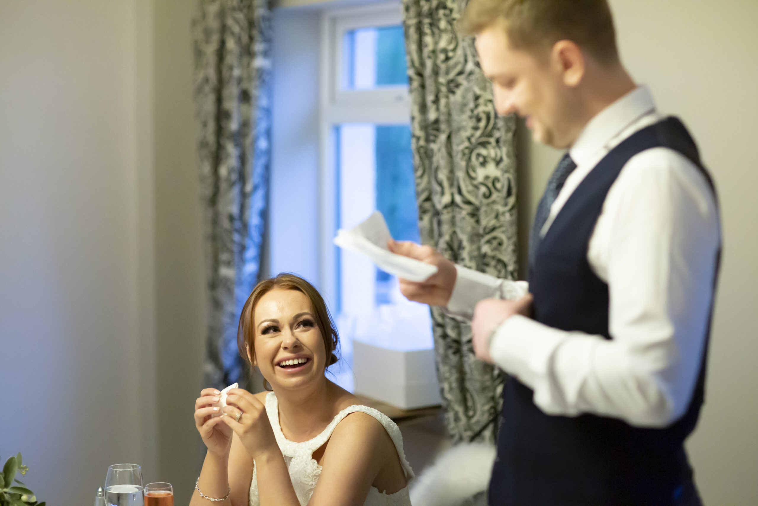 bride gets emotional at grooms speech at the wedding reception at gretna green hotel