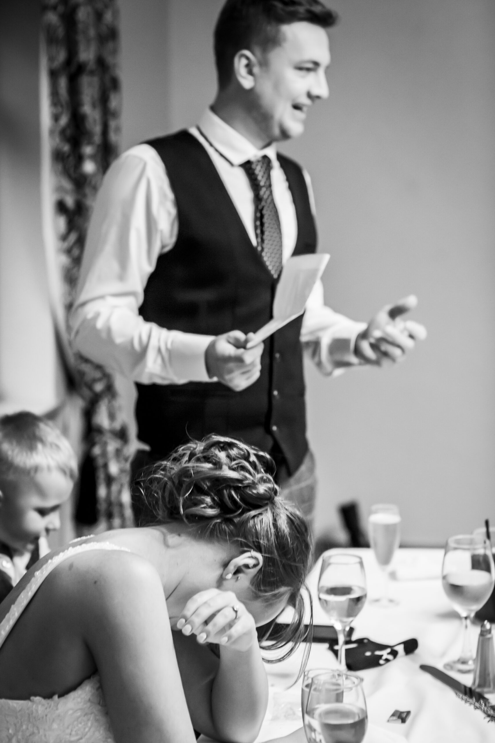 bride laughs during grooms speech at the wedding reception at gretna green hotel