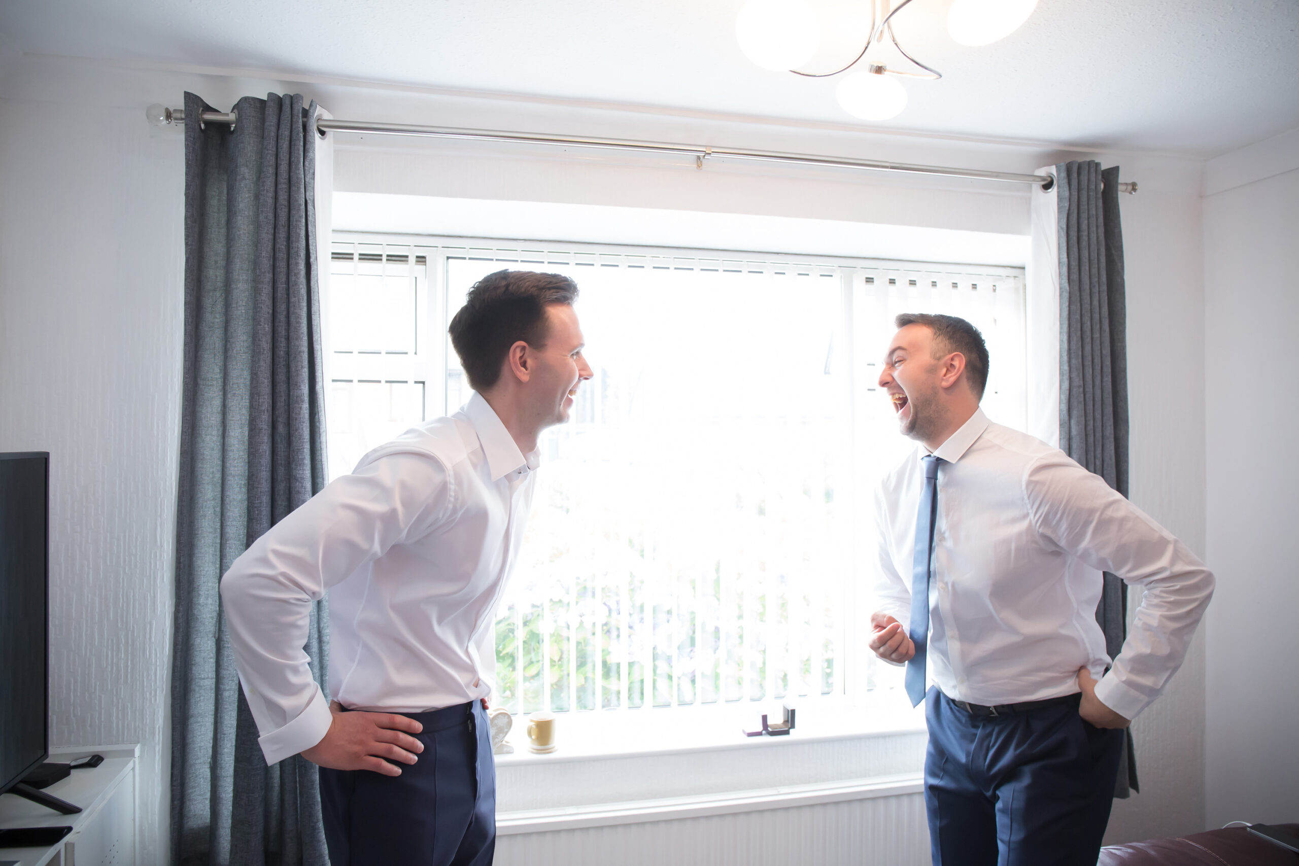 the best man and groom laugh together