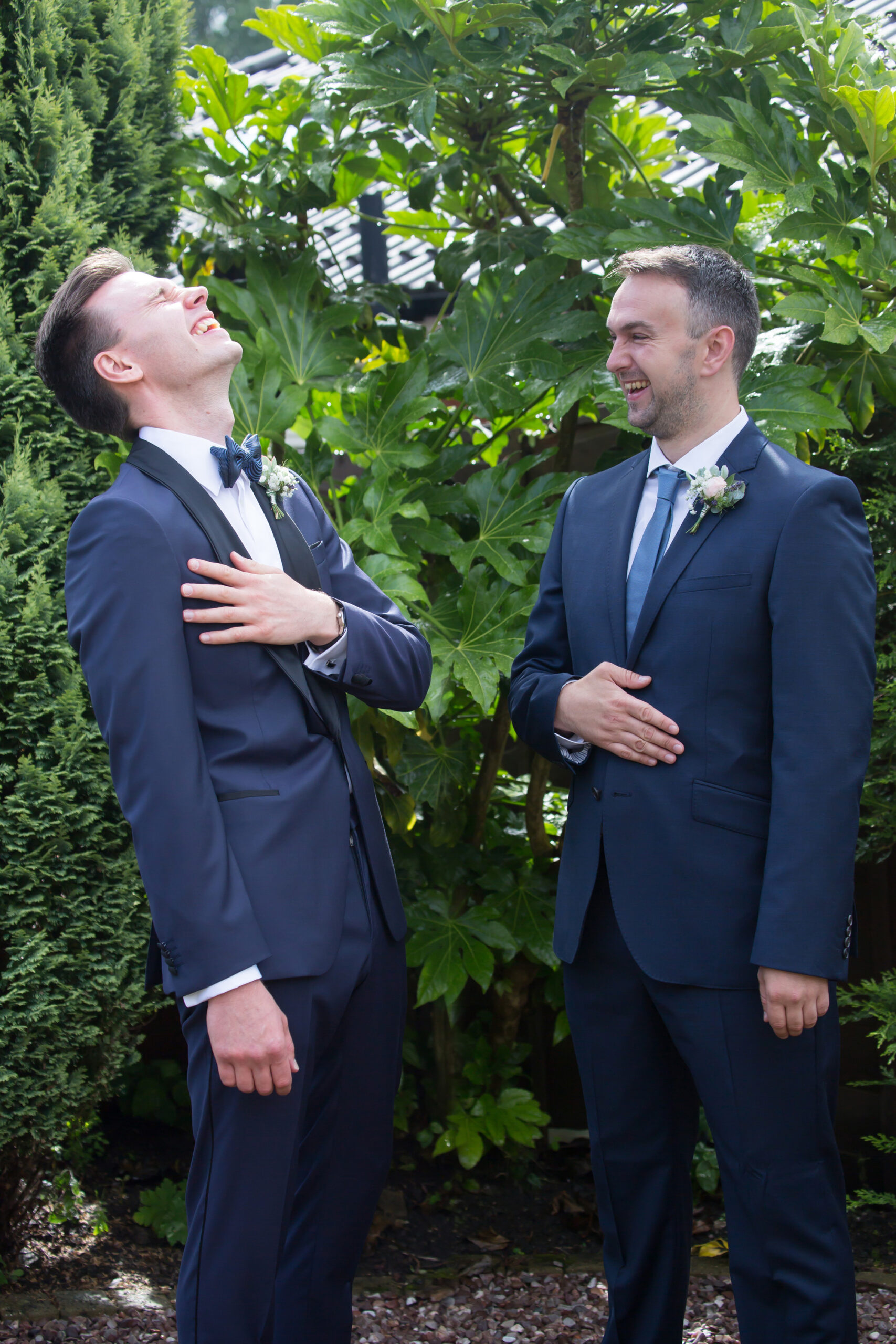 the groom and best man have a laugh together