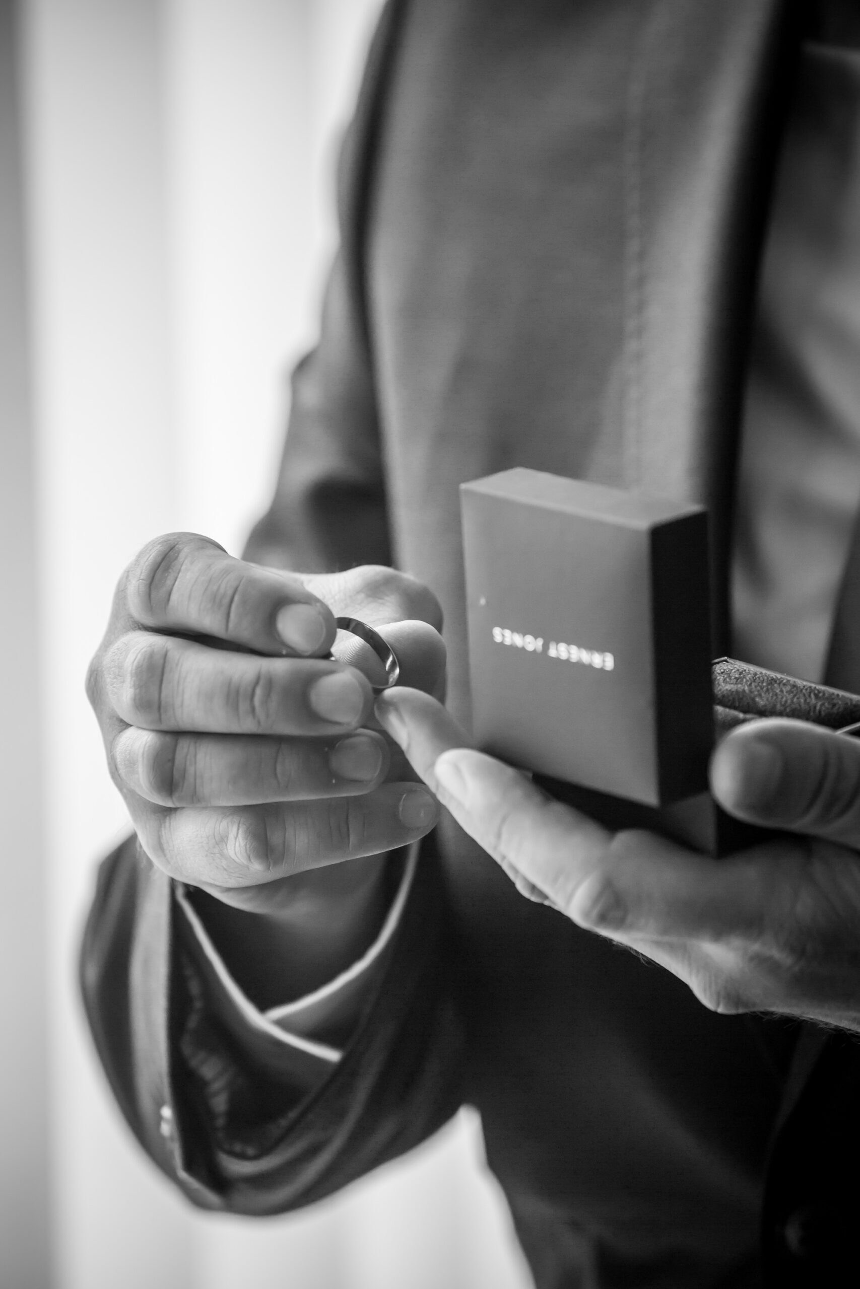 the best man holds the grooms ring