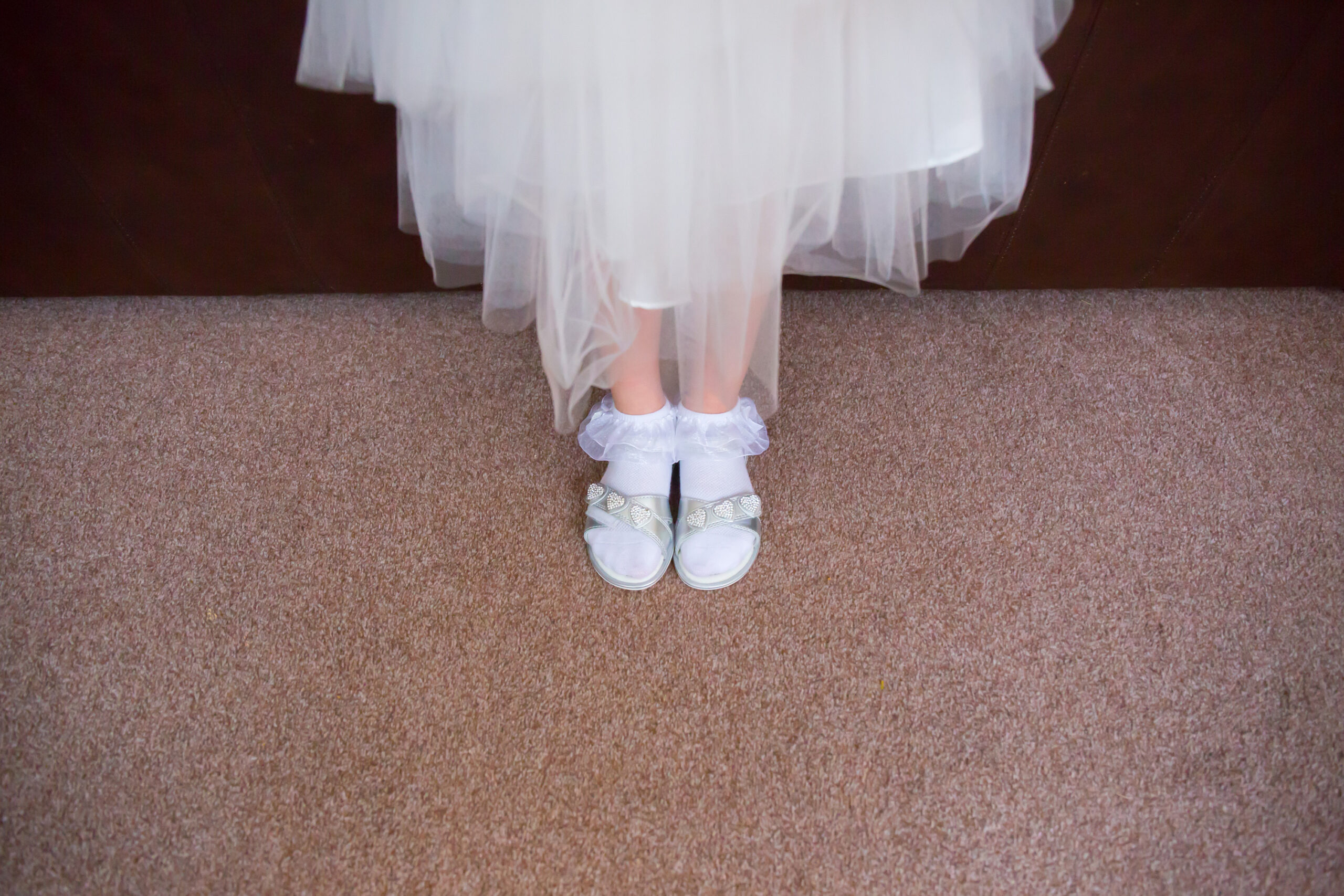 shot of the feet of the flower girl