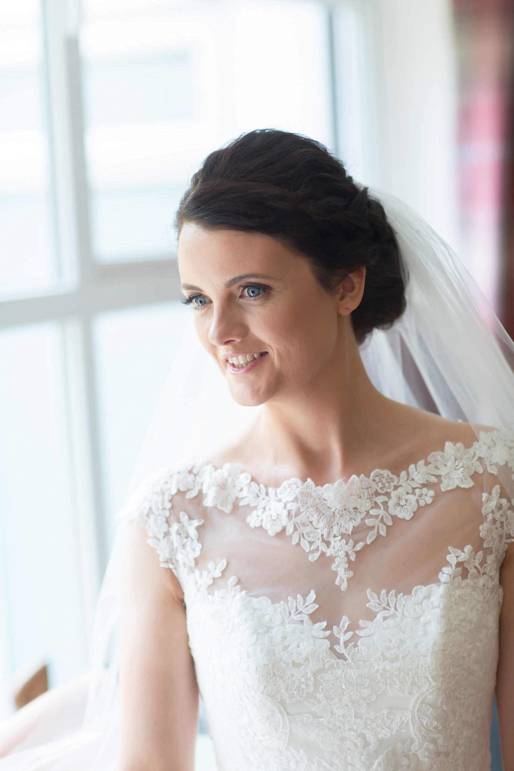 the bride looks radiant in a portrait