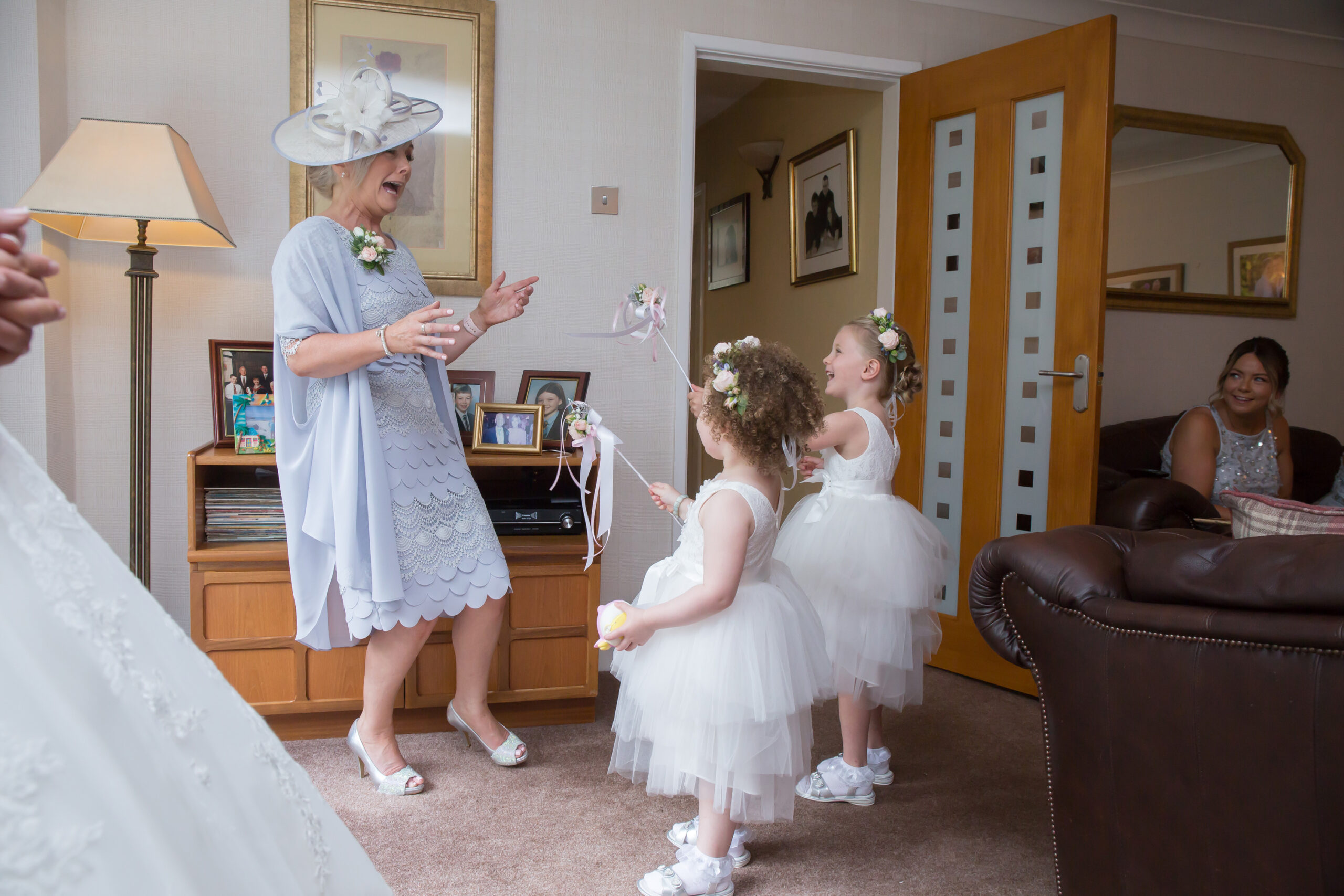 the flower girls surprise the mother of the bride who reels backwards