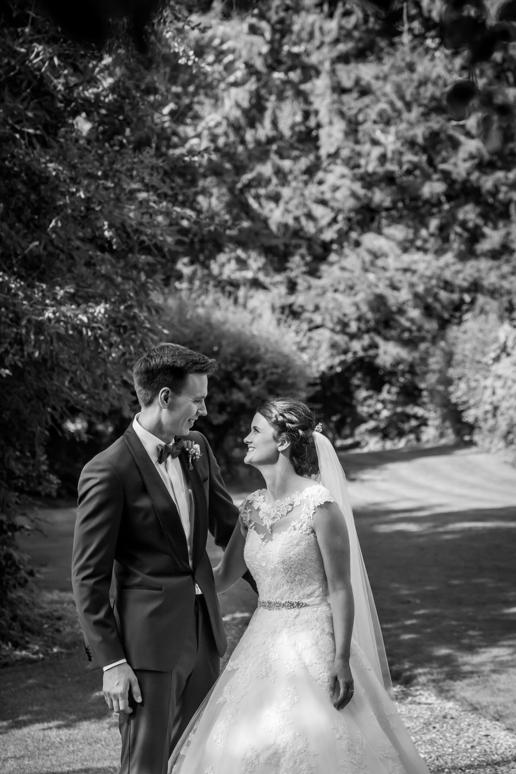 bride and groom in the sunlight in the gardens of mitton hall