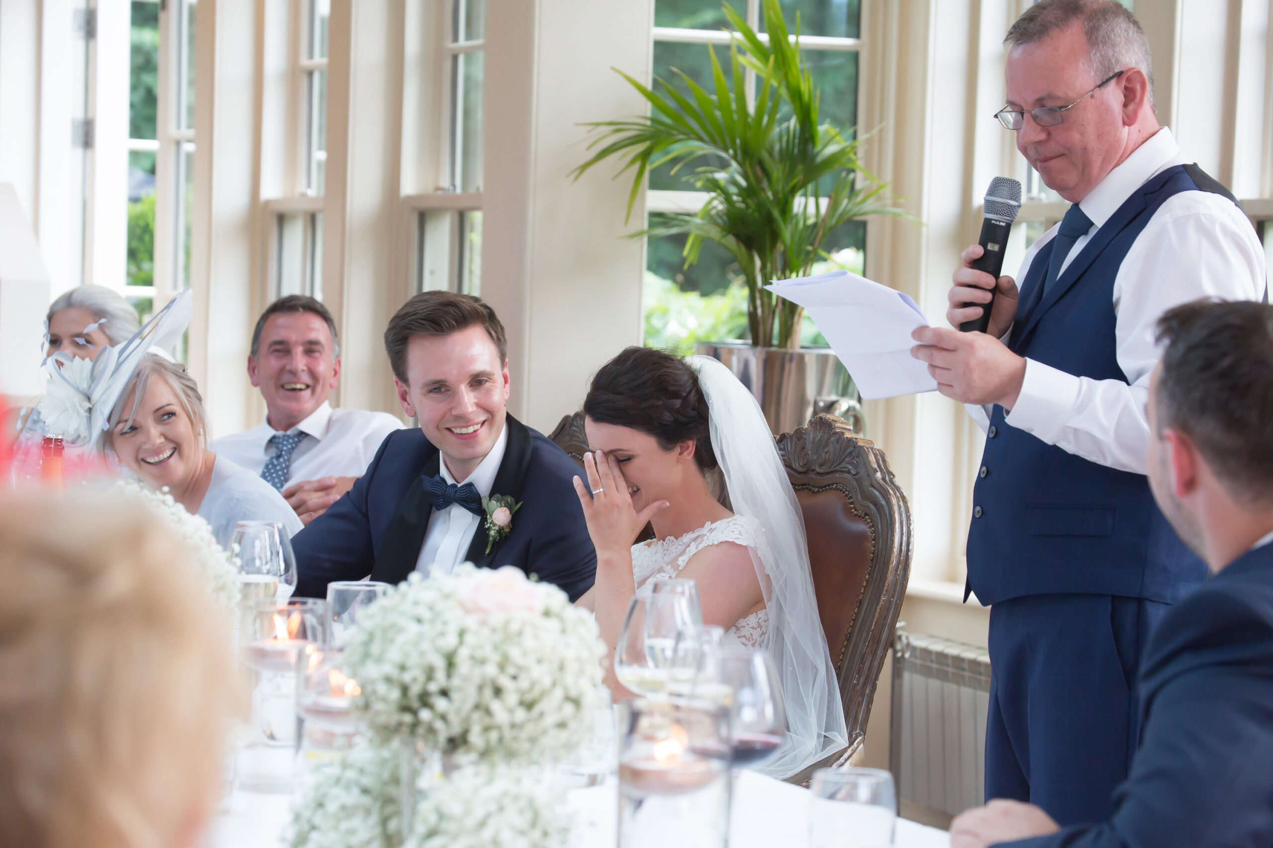 the bride hides her faces as her father delivers his father of the bride speech