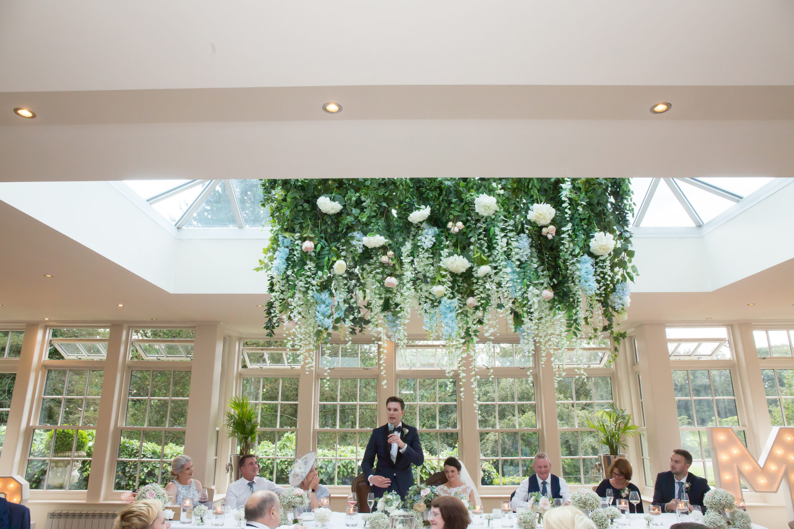 the groom delivers his speech in the conservatory at mitton hall