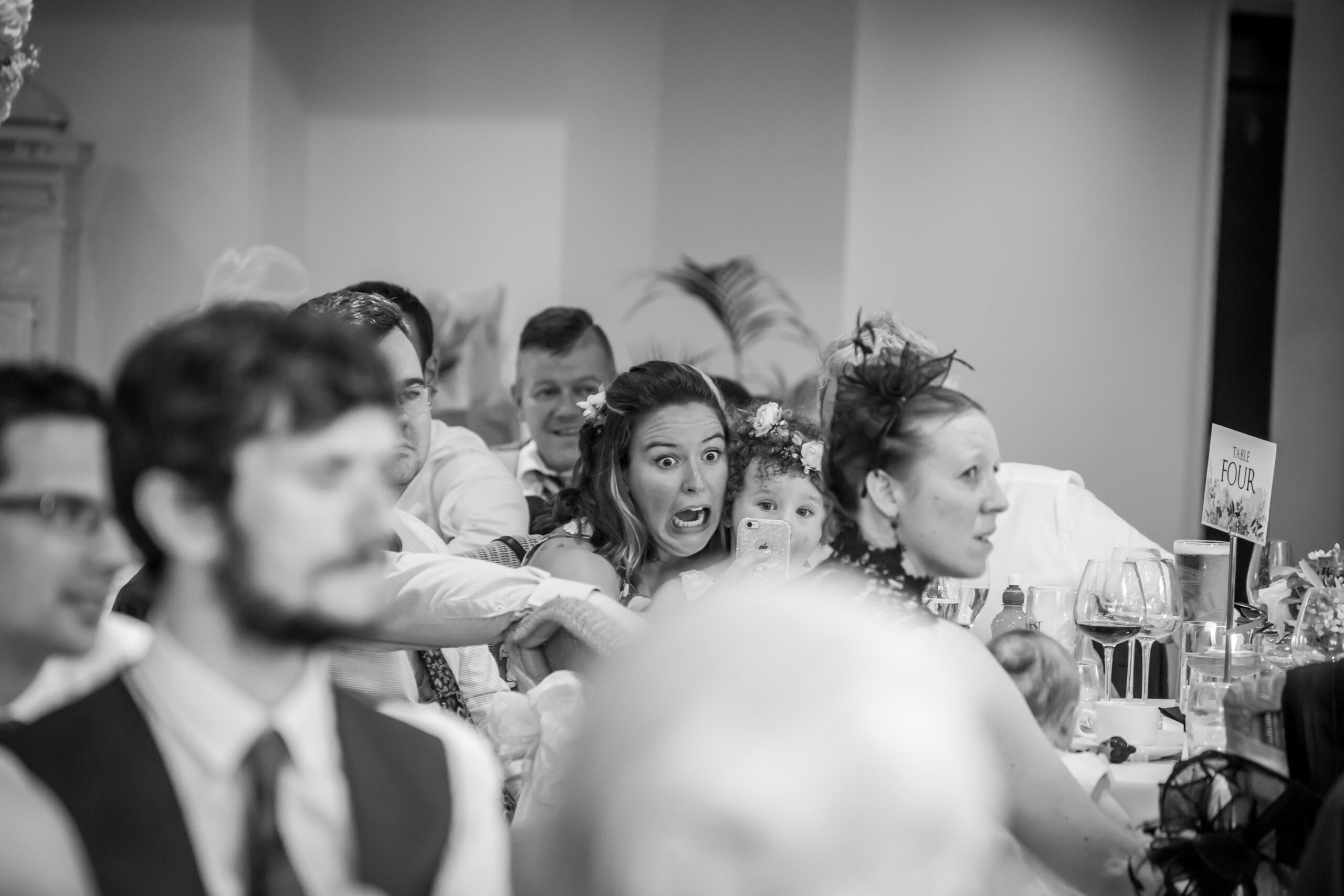 wedding guest has shocked look at phone during the speeches