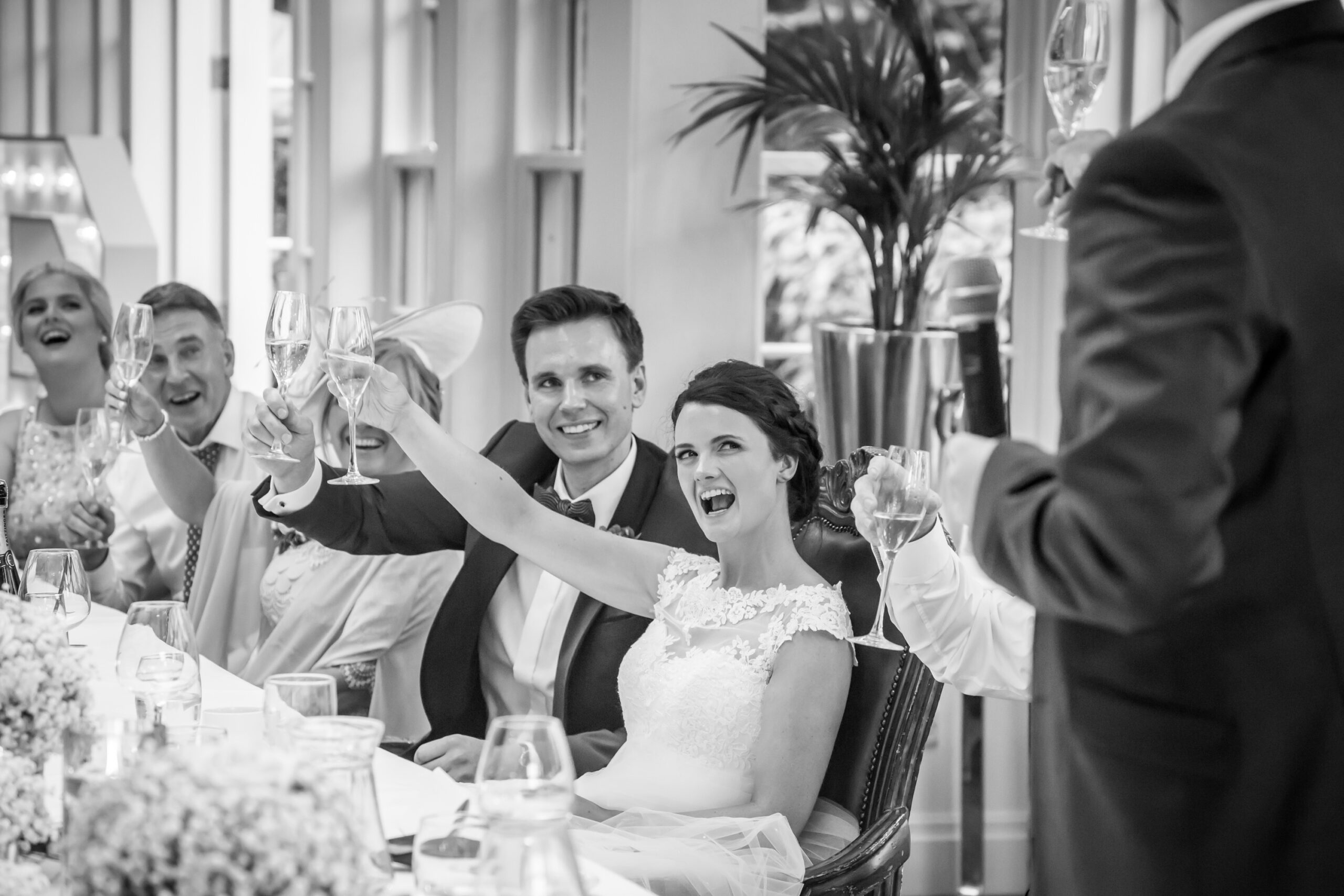 bride and groom toast the best man at the wedding speeches