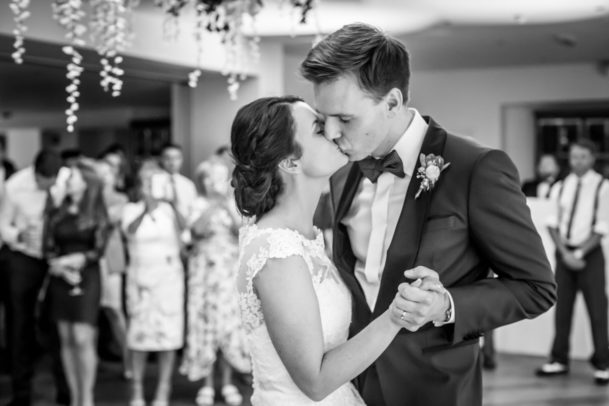 bride and groom kiss during their first dance at mitton hall in whalley