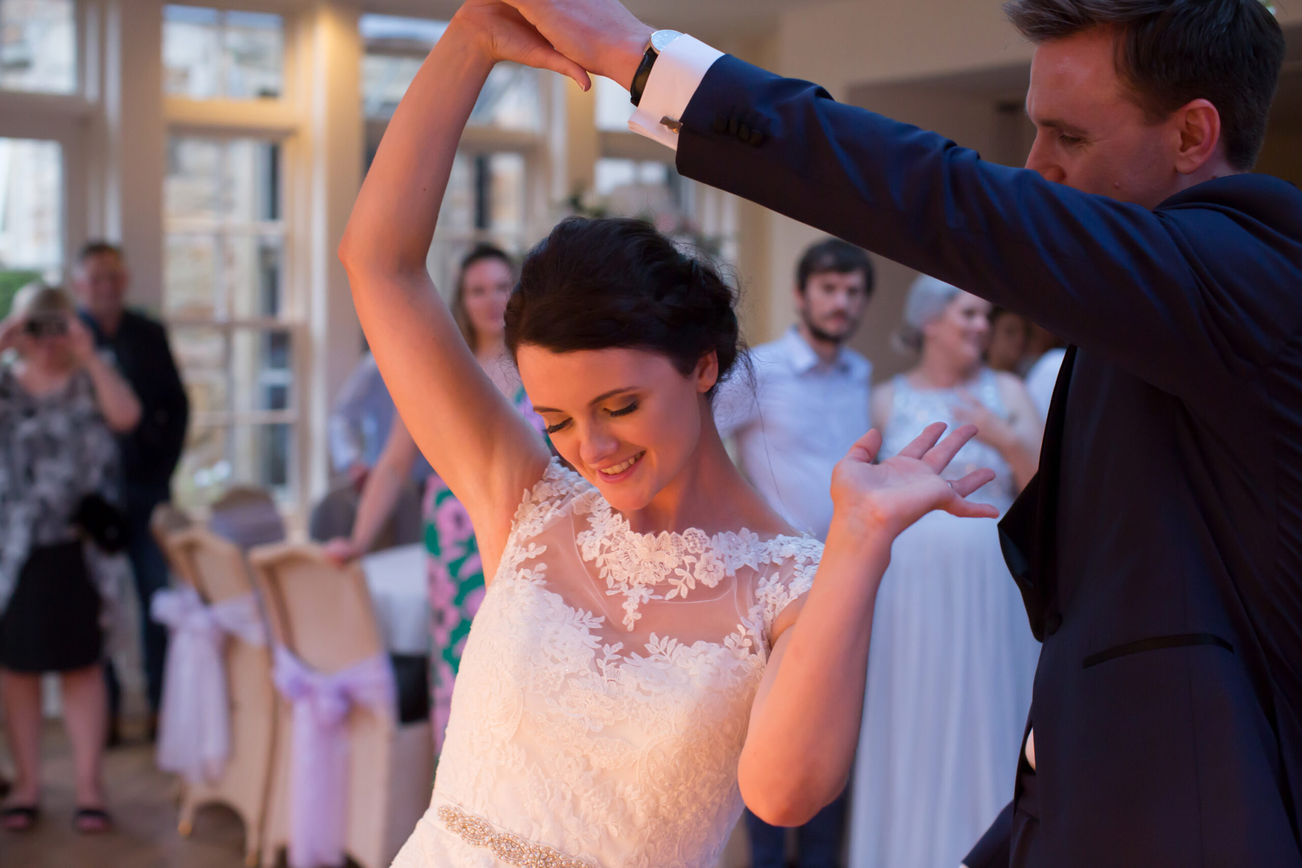 groom twirls bride during their first dance