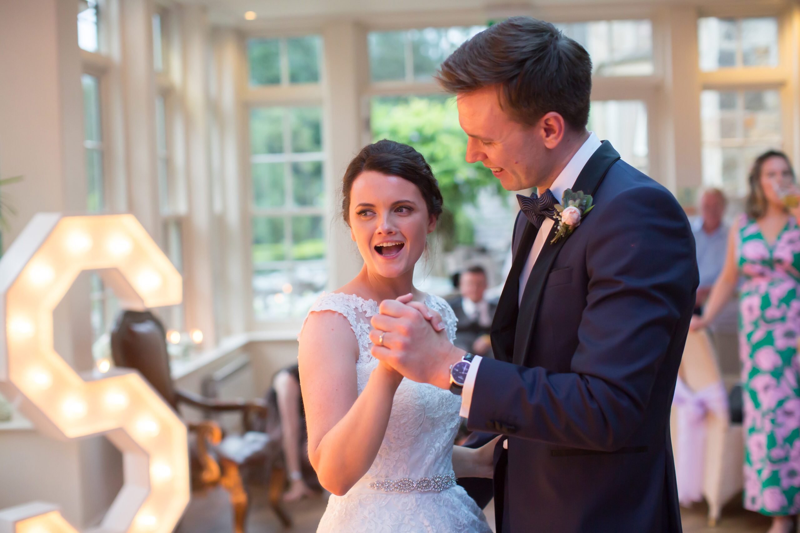 bride and groom enjoy their first dance at mitton hall