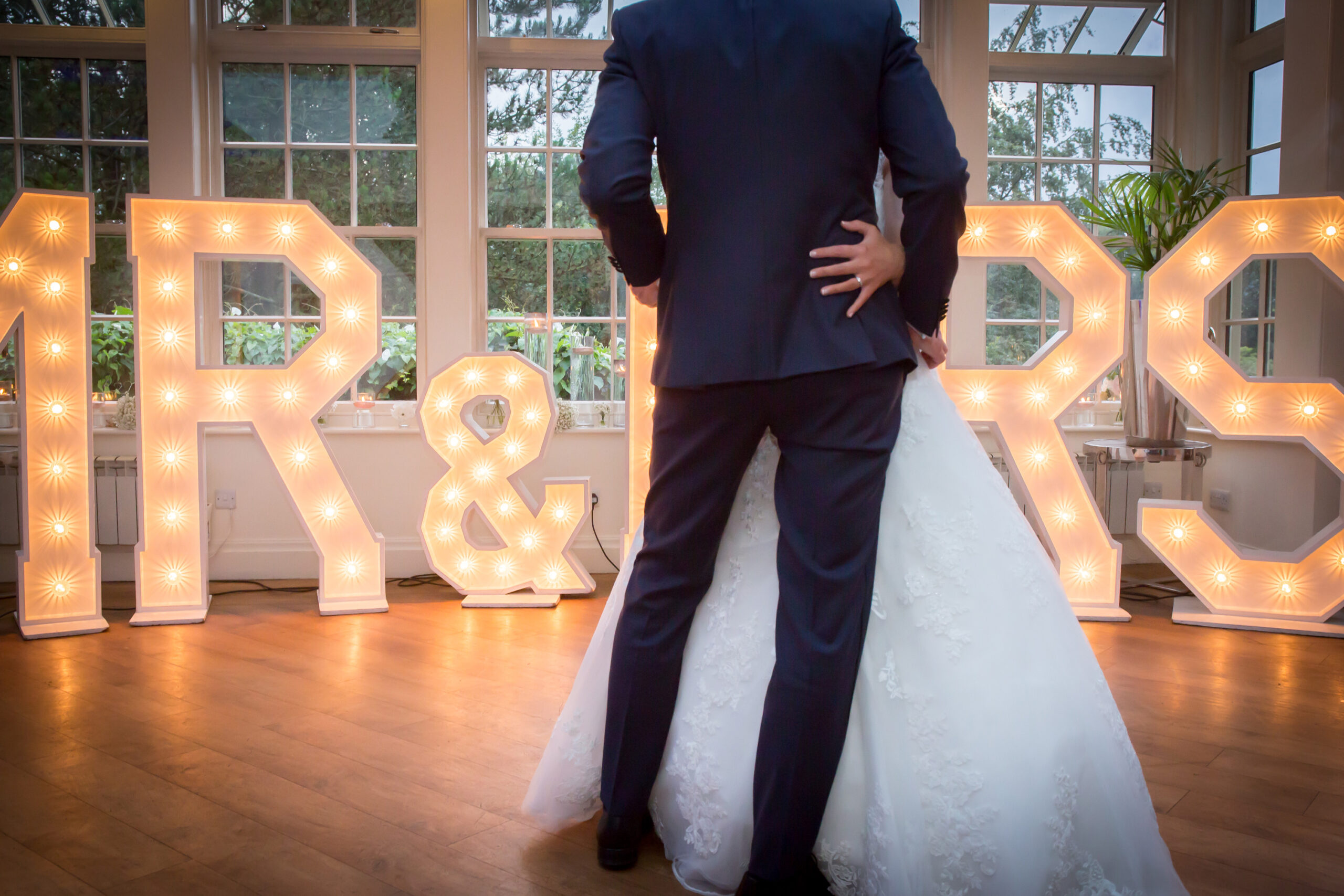 bride and groom in front of mr & mrs sign