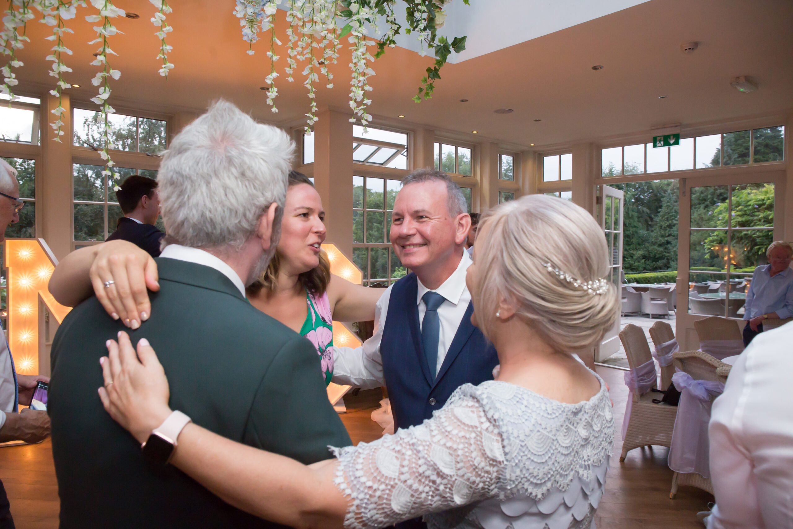 wedding guests celebrate together at mitton hall