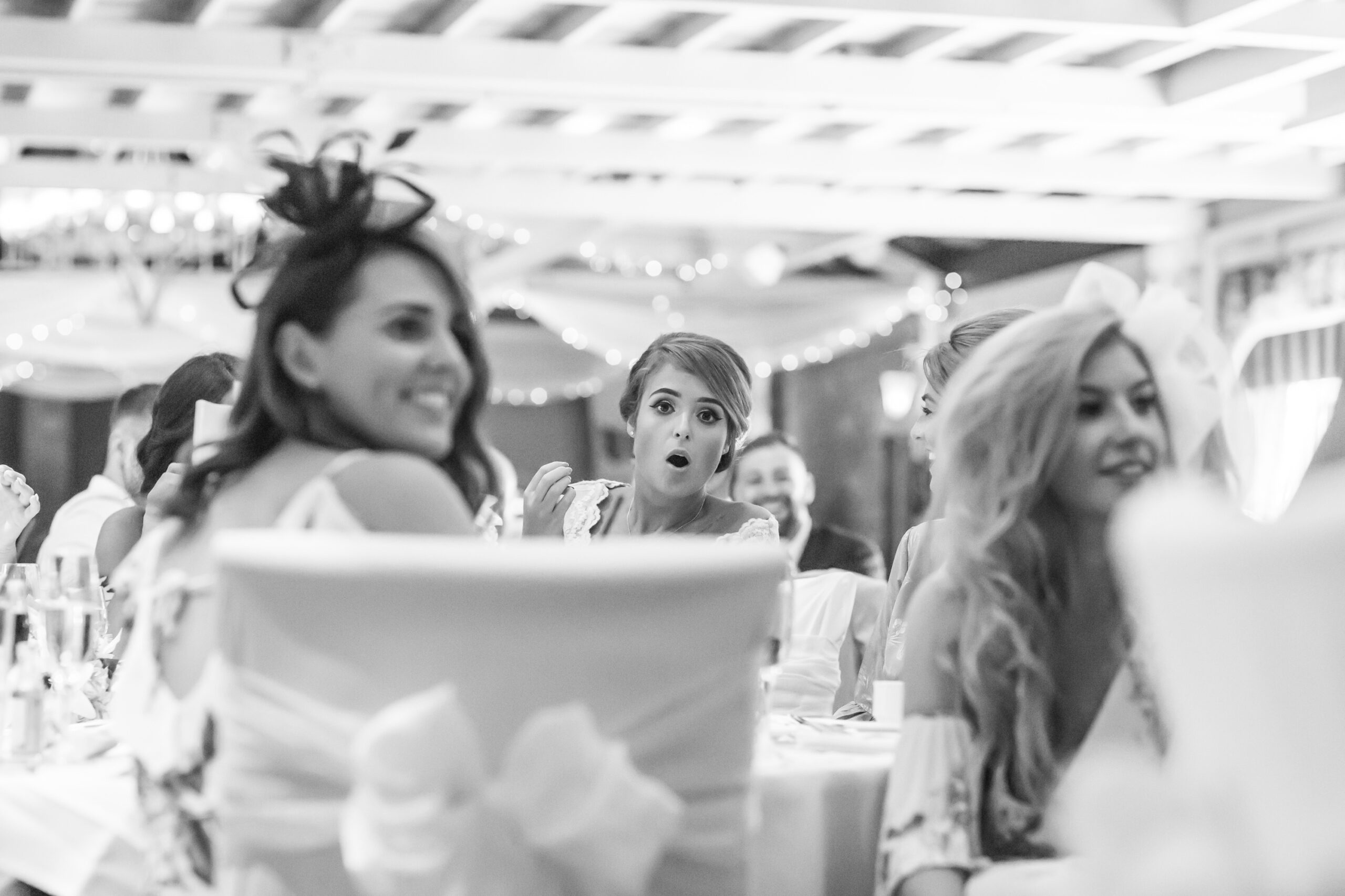 the bride screams with delight in front of the groom