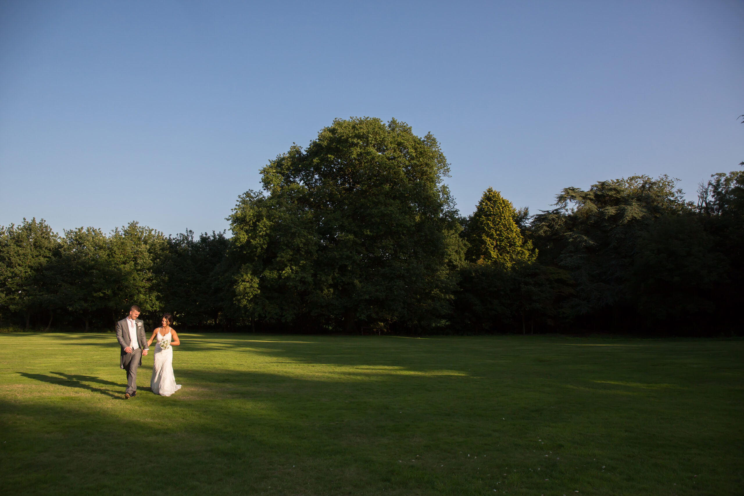 wedding guest and flower girl in the grounds of mitton hall