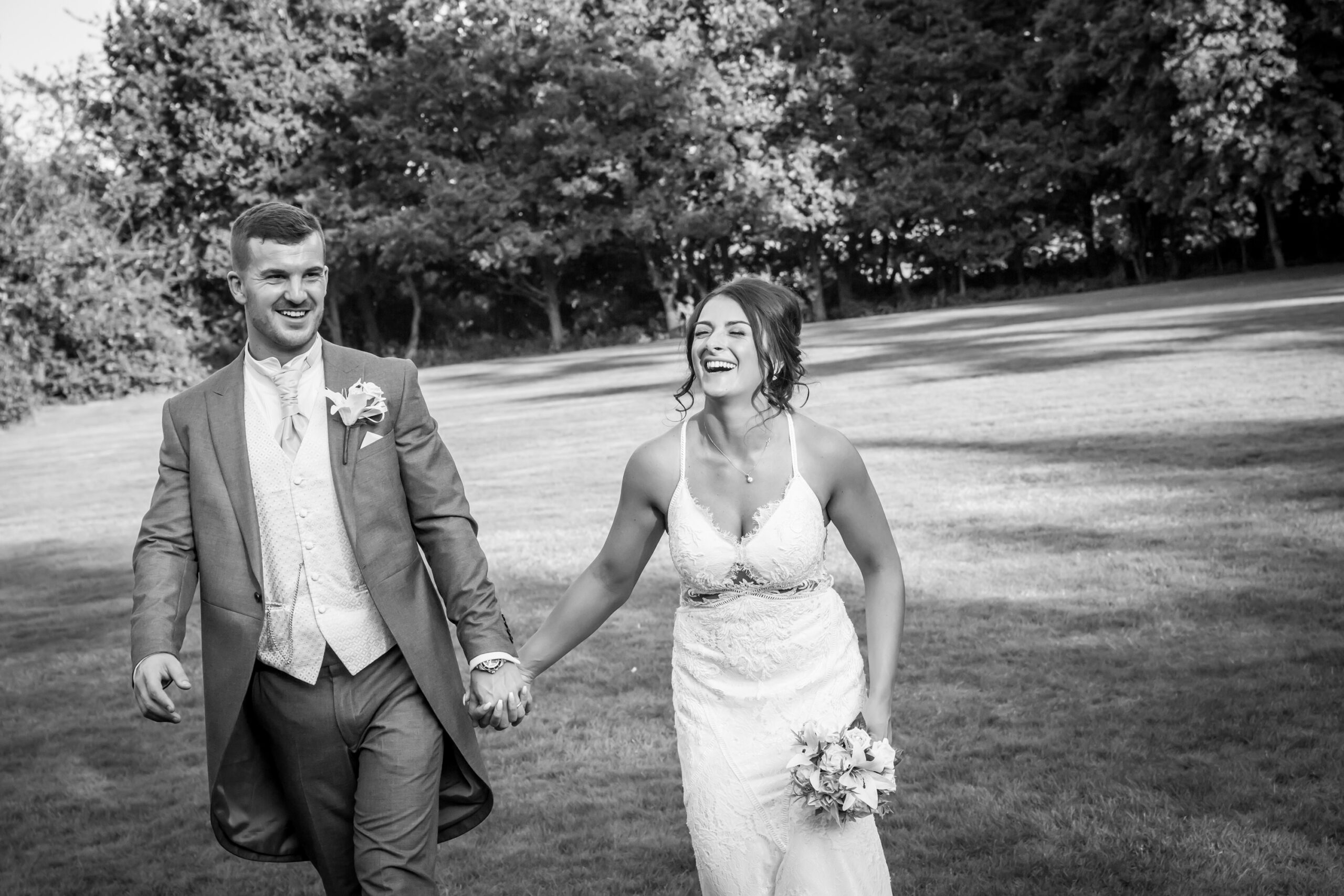 friends of the bride and groom having fun and kiss in the grounds of mitton hall